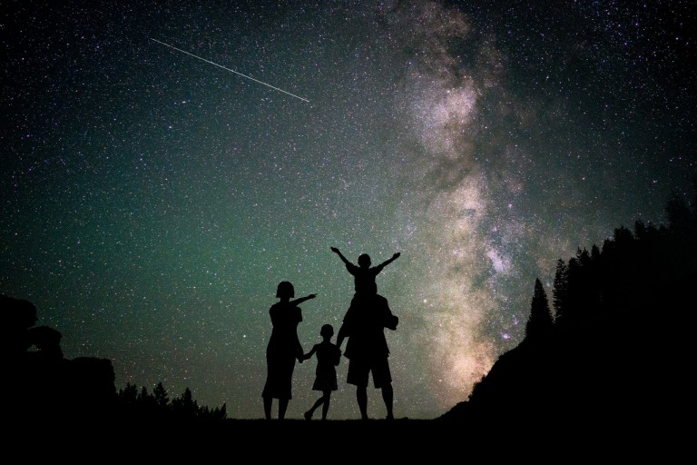 Family viewing the cosmos